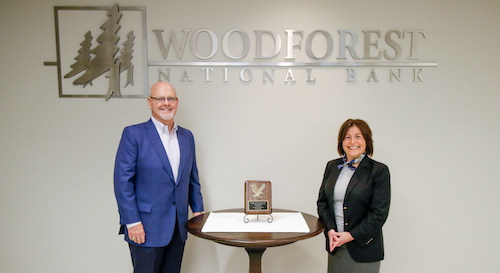 Pictured with the award is Jay Dreibelbis, President and CEO; and Julie V. Mayrant President of the Retail Division with Woodforest National Bank.